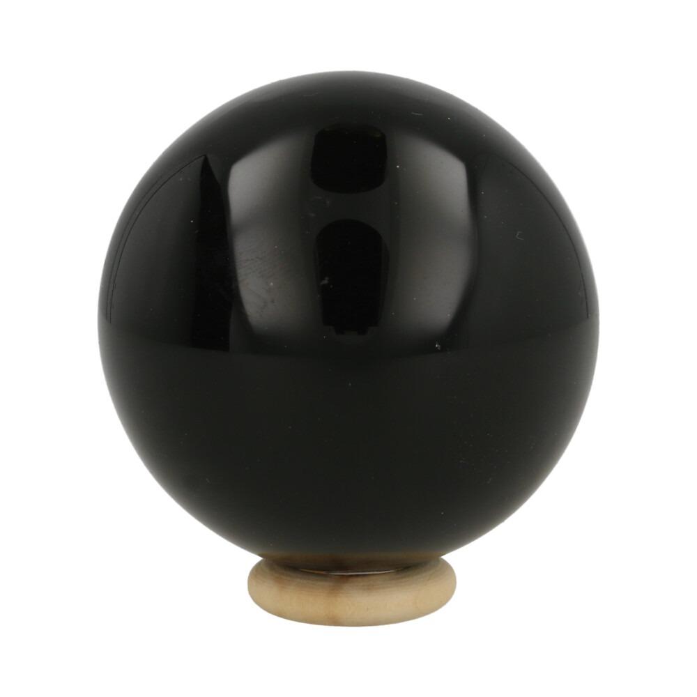 Zwarte obsidiaan bol met diameter van 58mm en houten ringetje